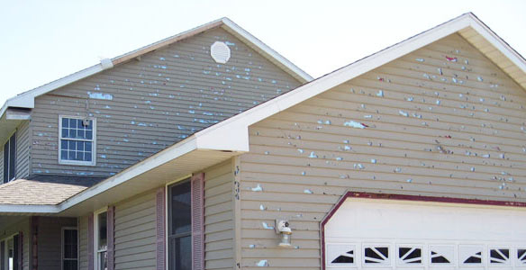 House with storm hail damage